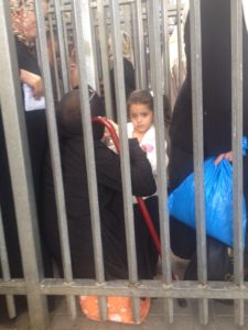 Girl at Qalandia Checkpoint, Photo: Ana C.